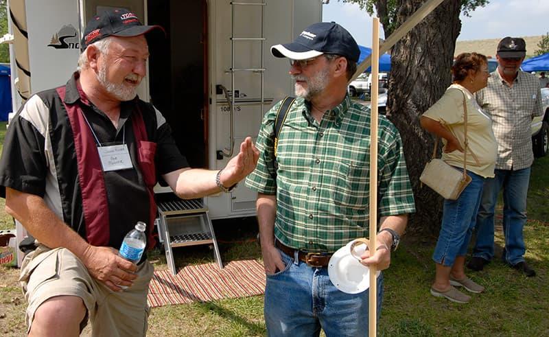 Bob Mehrer talking to an attendee