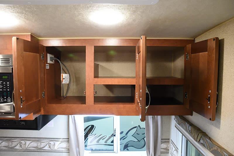 Arctic Fox 992 kitchen storage cabinets open