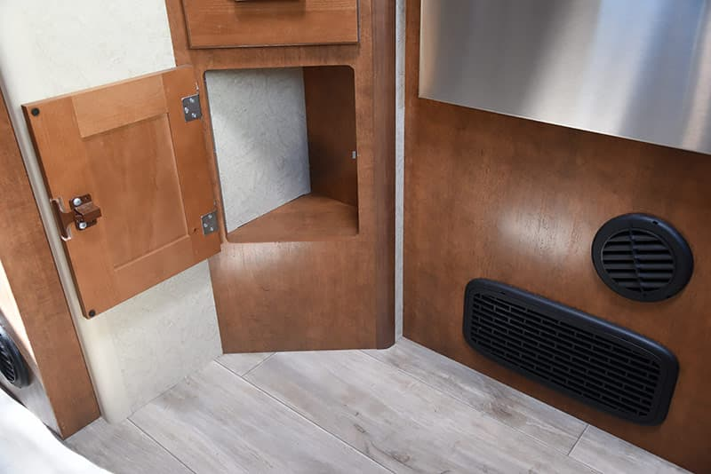 Lower kitchen cabinet storage area in Lance 975