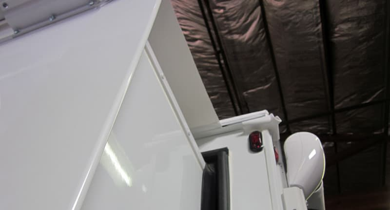 The anti-billowing mechanism locks the awning into place