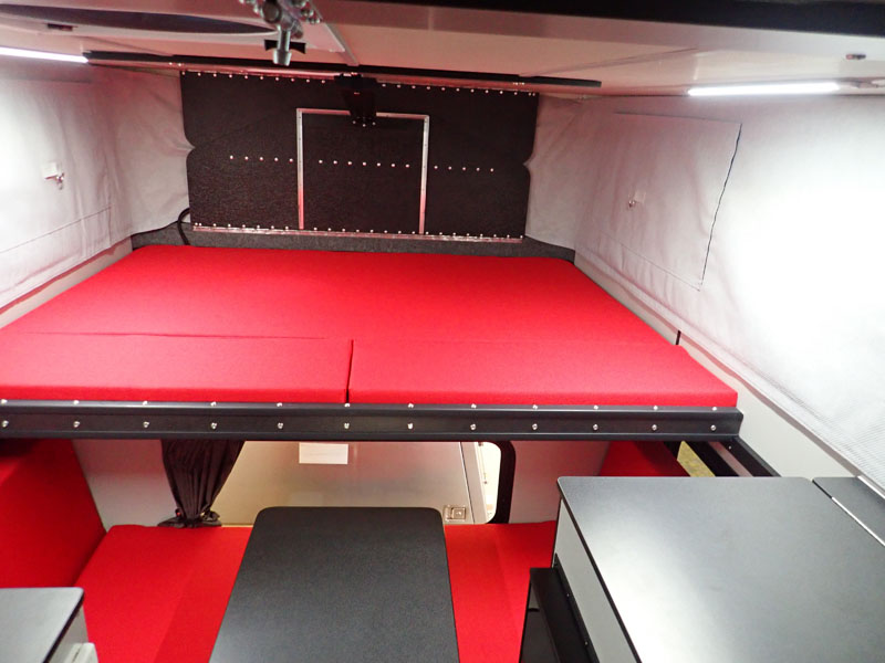Four Wheel Red Camper Bed