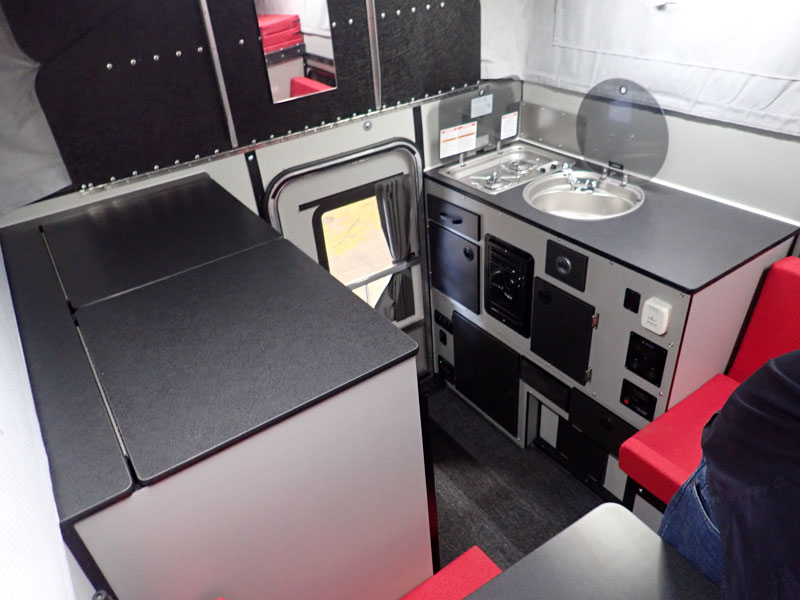 Four Wheel Red Camper main living area