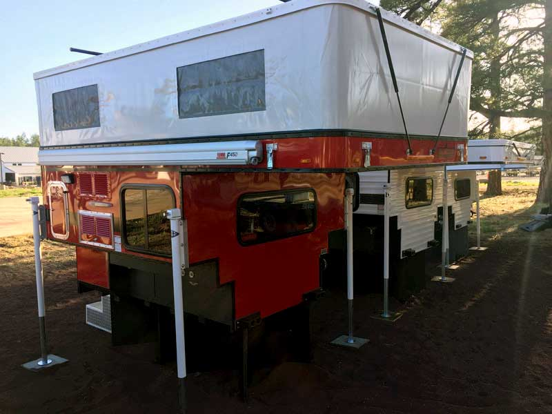 Red Four Wheel Camper Fiamma