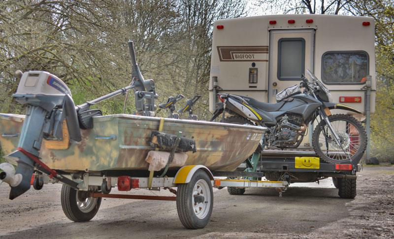 Aluminum Boat And Bigfoot Camper