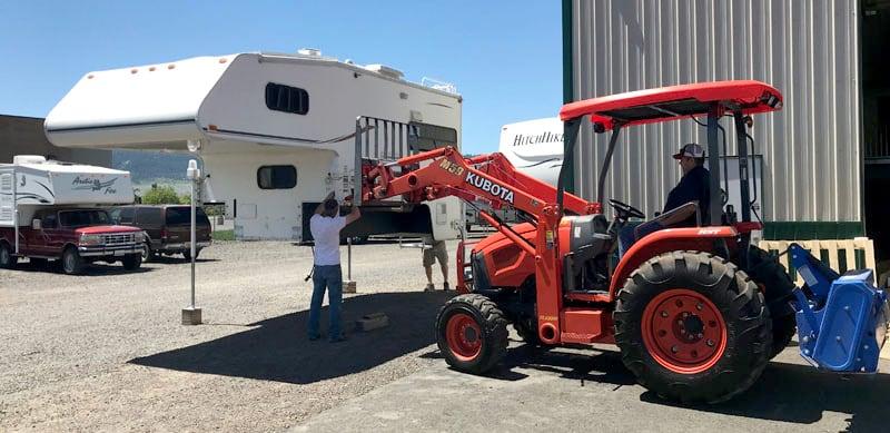Forklift Holding Camper Up