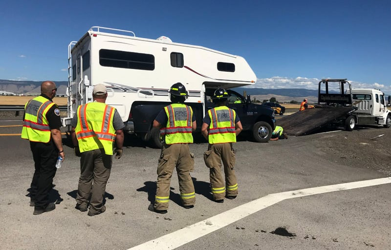Rescue Guys Watching Rig On Truck