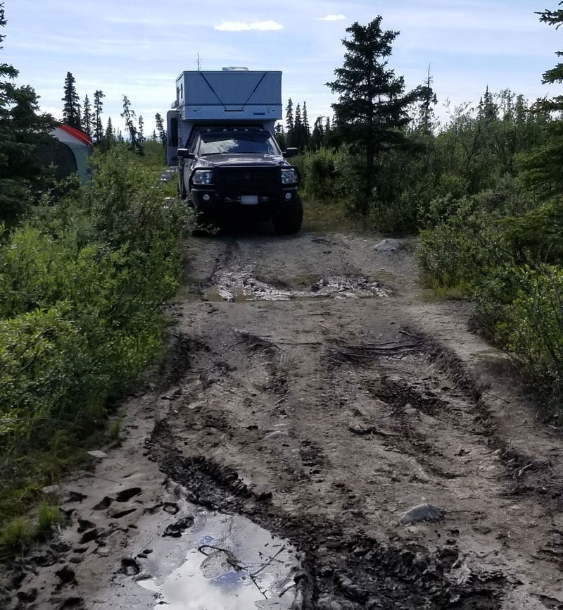 Alaska Muddy Road To Campsite On Lake