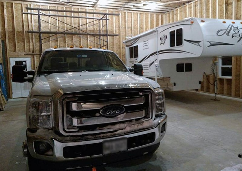 Truck And Camper In Garage Facility
