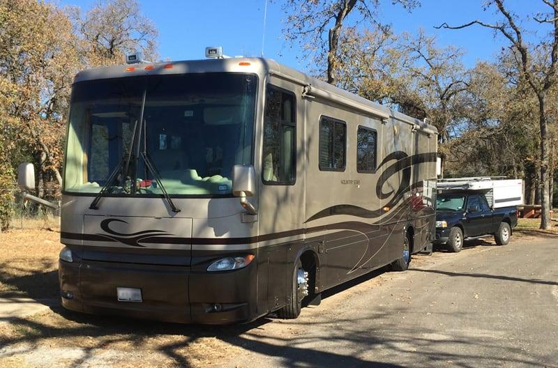 Motorhome Tows Popup Truck Camper