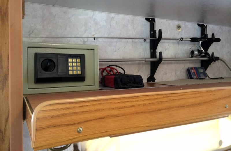 Fishing Pole Mount And Safe Storage Area