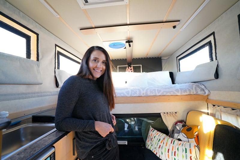 Mirella Inside Their Four Wheel Camper Swift