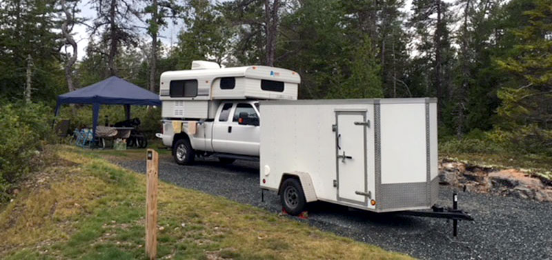 Campsite At Acadia Schoodic Woods Campground With Motorcycle Trailer In Foreground