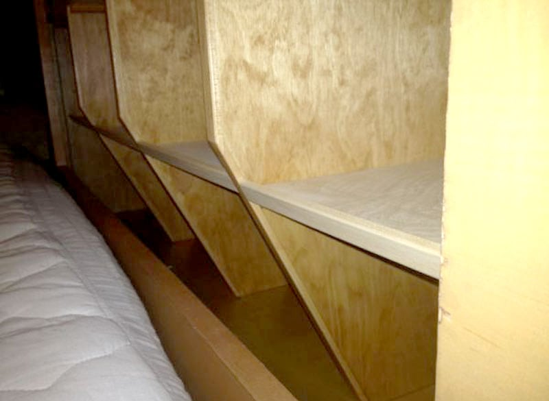Angled Shelving To Easily Make The Bed