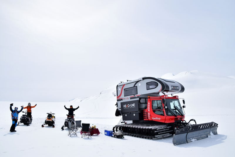 Camp Set Up On Ice Cap And Snowmobiles