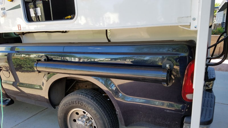 Magnetic Sewer Hose Carrier Attached To Truck