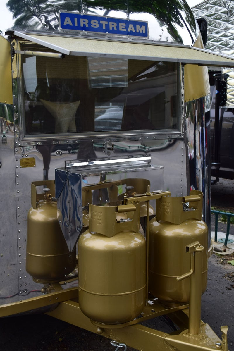 Airstream With Golden Propane Tanks