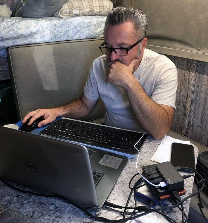 Paul Working Inside Of The Capri Truck Camper