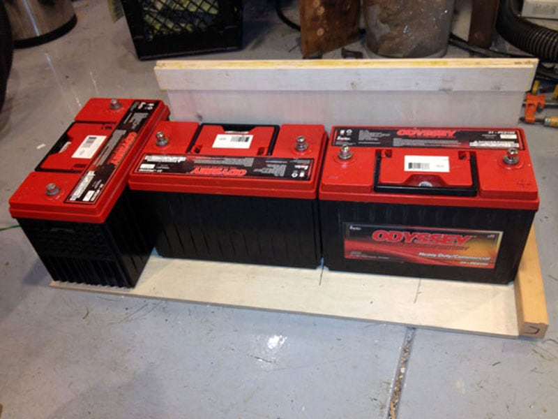 Camper Batteries Laid Out Before Going Into Basement