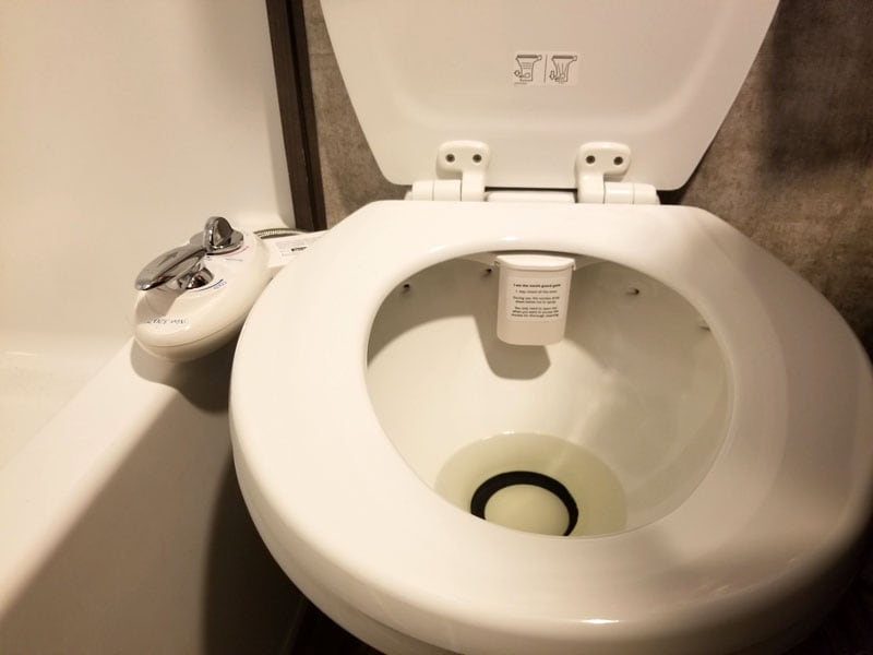 Ceramic Toilet And Bidet In Use