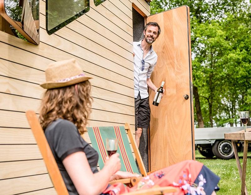 Haaks Camper Couple Sitting Outside Wine