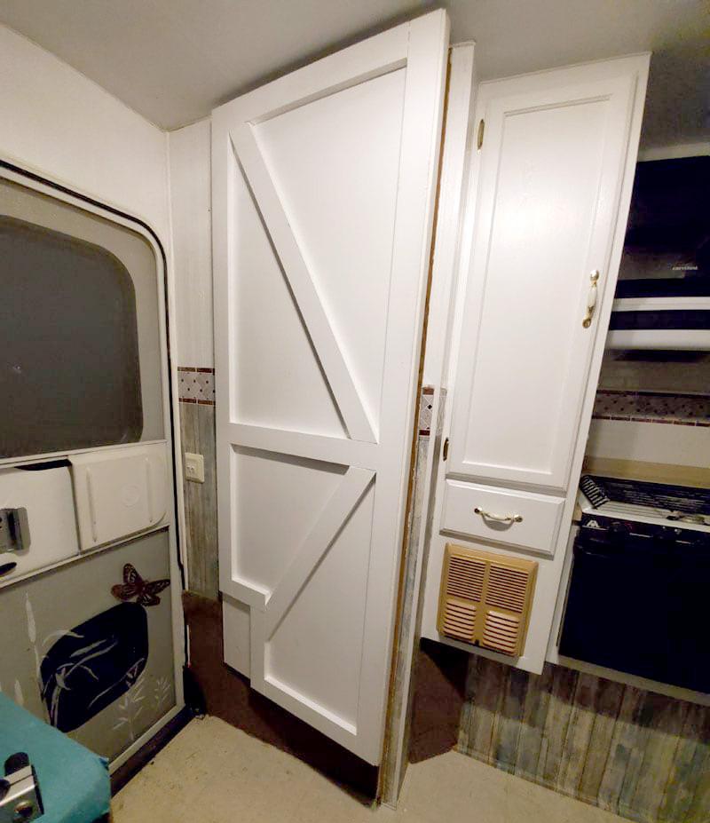 New Camper Barnyard Door White Cabinetry