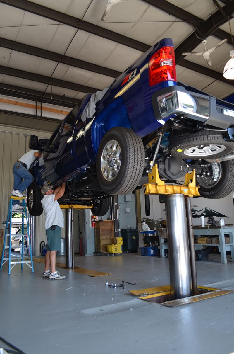 Truck On Lift Turnbuckle Installation At Parkview
