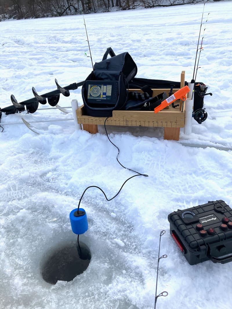 Ice Fishing Hole With Supplies