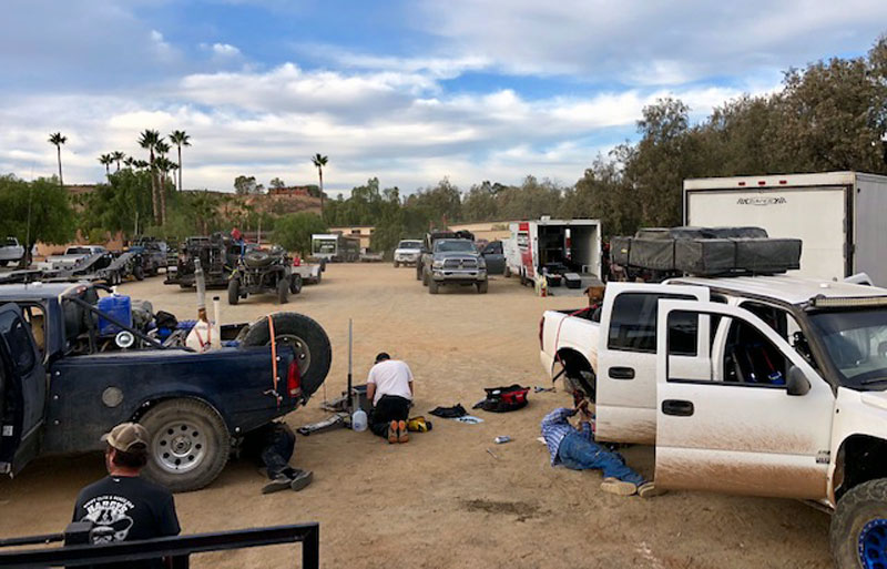 Fixing broken prerunners at Horsepower Ranch in Ensenada after running particularly grueling section of SCORE 1000.