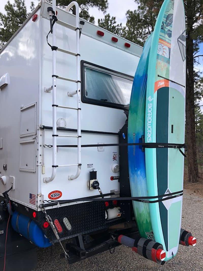 Kayak And Paddleboard On Back