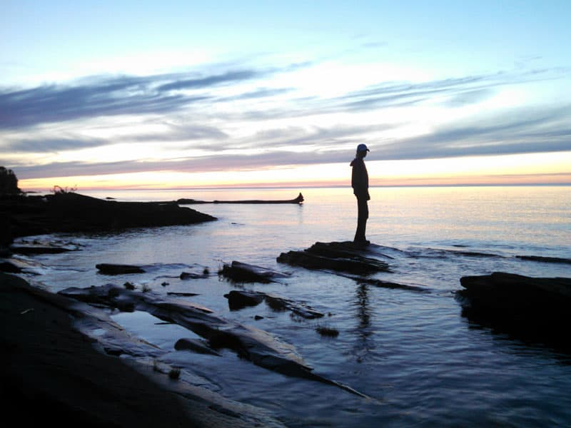 Sunset Standing On A Rock In Lake Superior
