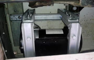 Compressor placed in outside storage compartment