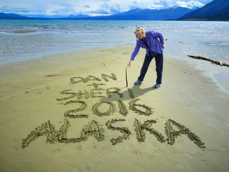 Alaska sign in sand