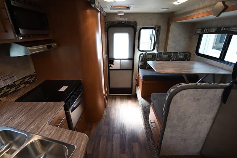 Adventurer 89RBS dinette, kitchen, and wet bath