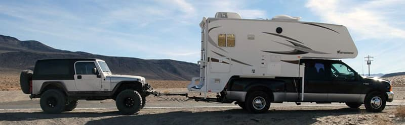 Flat towing a Jeep with a truck camper
