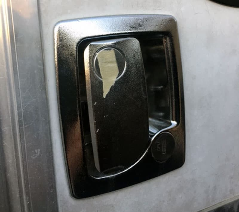 masking tape over the entry door lock key hole