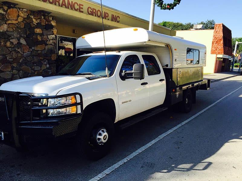 Alaskan flatbed 11-foot truck camper