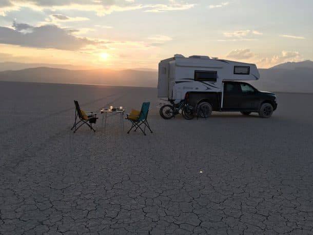#250 - Glen and Trudy PritchardAlvord Desert, SE Oregon2017 Ram 35002017 Northstar Laredo SCCamera Used - iPhone SEThis felt like camping on the moon!  In the center of the Alvord Desert, with nobody else in site as far as we could see, it was peaceful and surreal.  You have to watch the weather when camping here so that you do not get caught in a thunderstorm or downpour.  This was a September day so the weather was perfect and not too hot.  We set out our table, a bottle of wine, and dinner.  We felt like we had the entire landscape to ourselves.