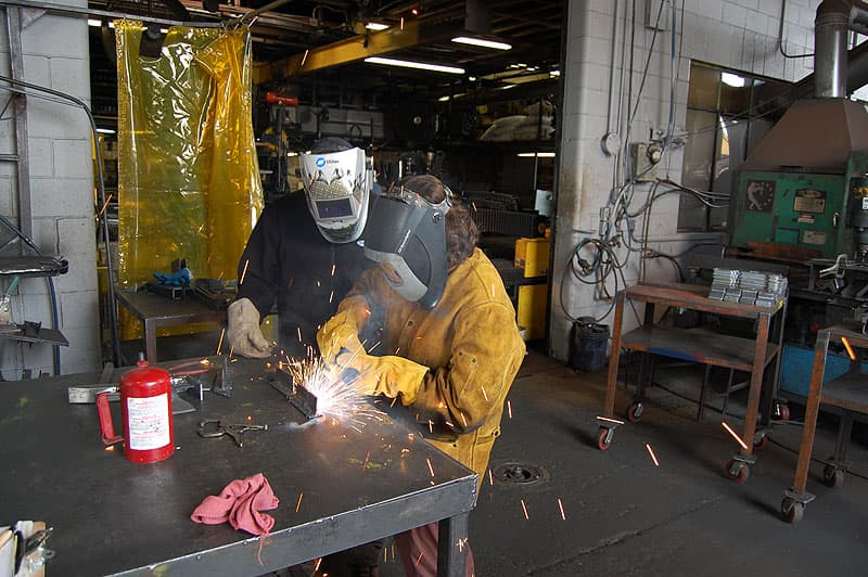 Angela welding at Torklift