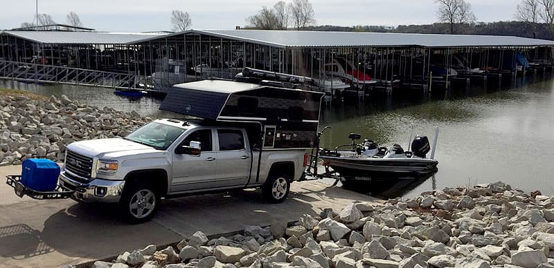 Truck camper backing down boat launch