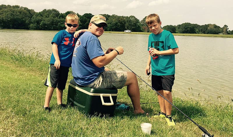Troy O'Rourke fishing with his kids