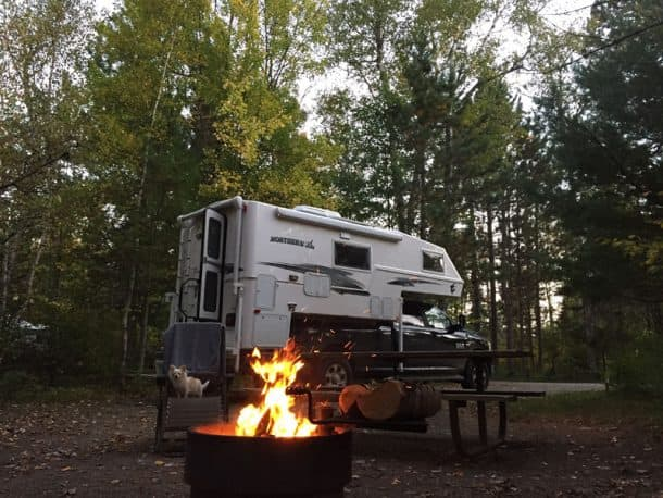 #222 - Doug JensenBear Head Lake State Park, Ely, Minnesota2017 Ram 35002017 Northern-Lite 10.2 EX CDSECamera Used - iPhone 7This shot was taken at Bear Head Lake State Park just outside of the Boundary Waters Canoe Area Wilderness of Northeastern Minnesota with my little travel buddy, Cody, in the chair enjoying an early fall campfire after a day of hiking the north woods.