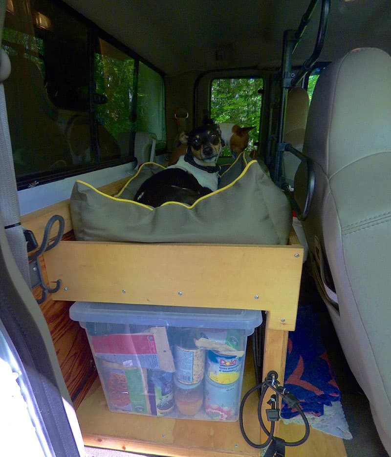 Raised platform back seat storage in truck
