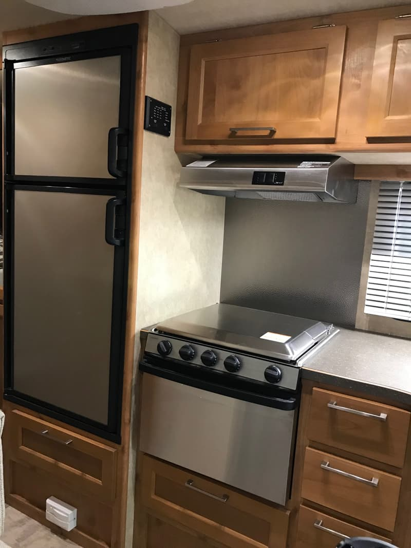 Bigfoot Camper Stainless Kitchen In Canoe Birch