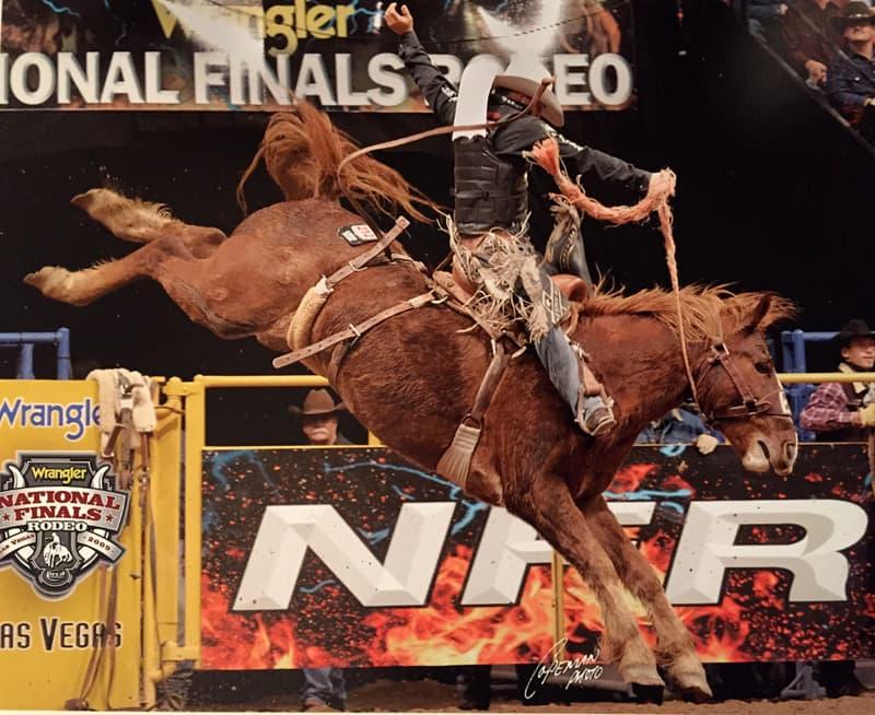 Bradley-Harter-riding-Bronc