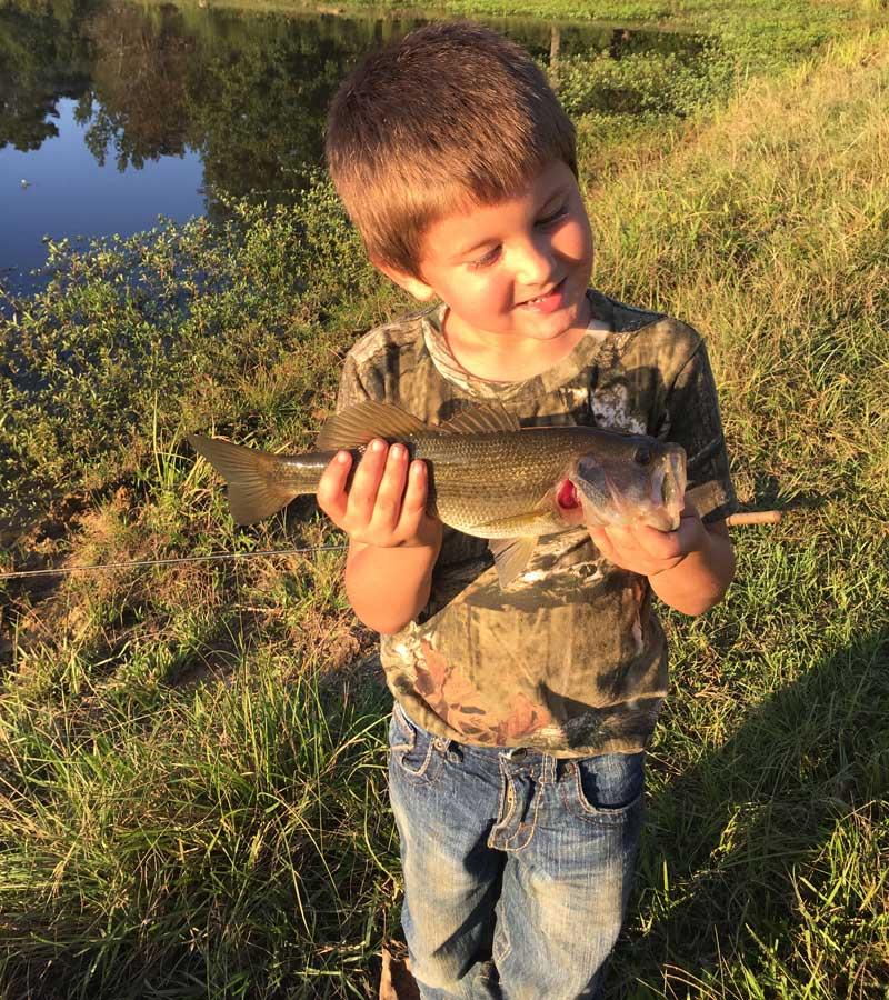 Bradley-Harter-son-fishing