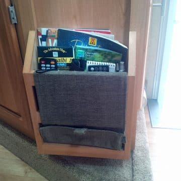 Camper magazine rack with other supplies