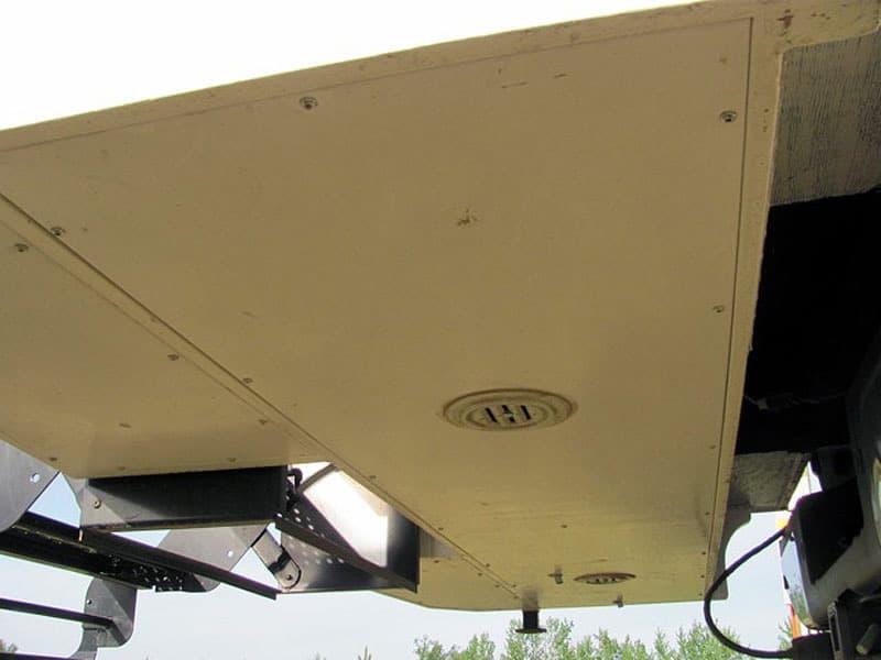 Under overhang, grey tank storage