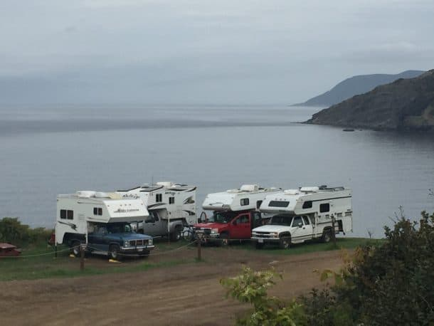 #266 - Joe ZeccaMeat Cove, Cape Bretton Island, Nova Scotia2011 Chevy Silverado 35002012 Arctic Fox 1140Camera Used - iPhoneThe photo shows four truck campers parked on the edge of the cliff, over the ocean, at Meat Cove, Cape Bretton Island, Nova Scotia.  We were all touring Nova Scotia caravan style, and this was the northernmost point of our journey.