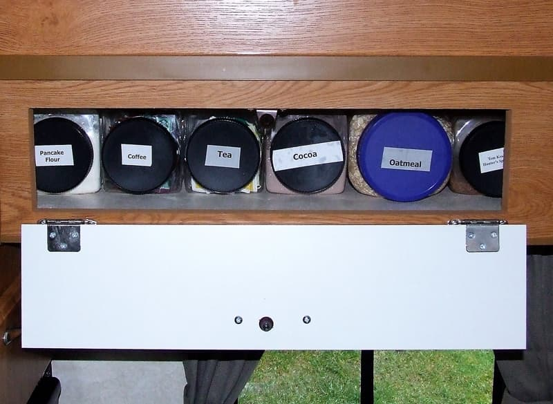 Canisters on shelf to store food items