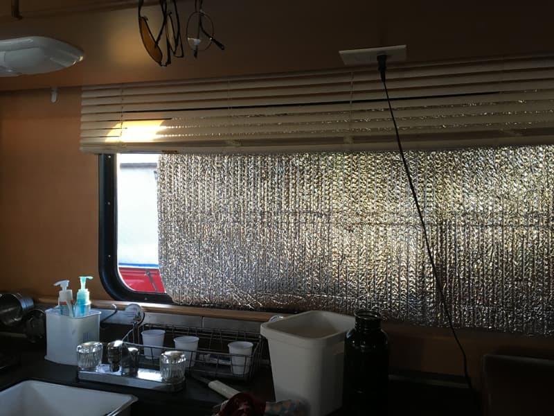 Insulation with blinds partially down